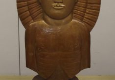 Male head with sun motif