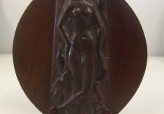 Female nude relief in oval stand