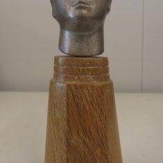 Silver head with bird headdress