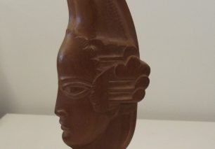 Head with winged elongated headdress